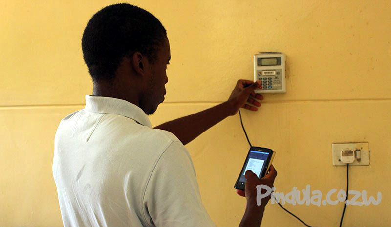 Person Recharging ZESA Electricity Meter