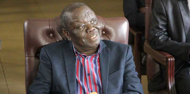 Morgan Tsvangirai Sitting down