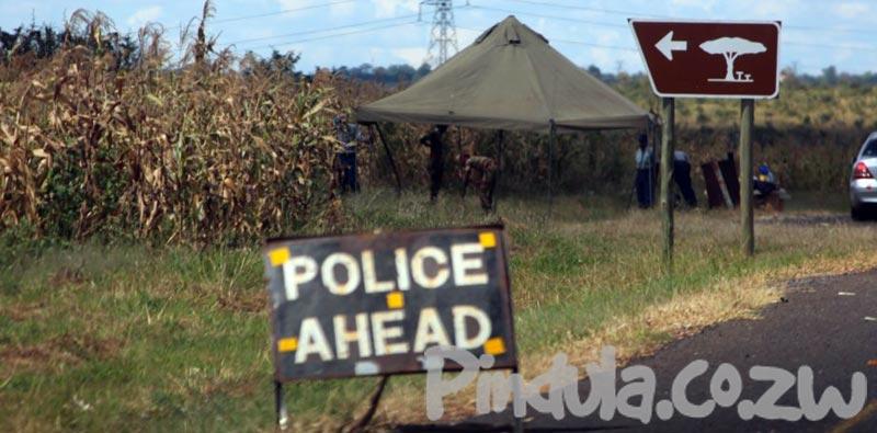 Police Ahead Sign Roadblock