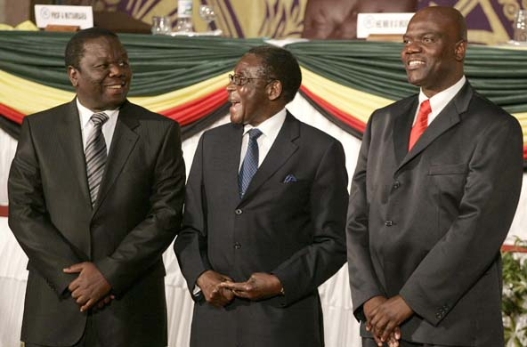 Zimbabwe's late former President Robert Mugabe (C) laughs with opposition leaders Tsvangirai and Arthur Mutambara after signing a power-sharing deal in Harare Running mate clause