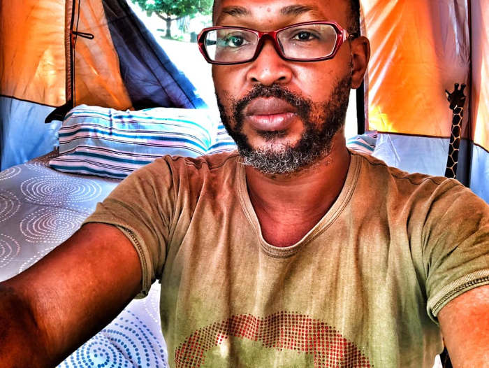Pics: Popular Comedian Carl Ncube Chooses To Live In A Tent