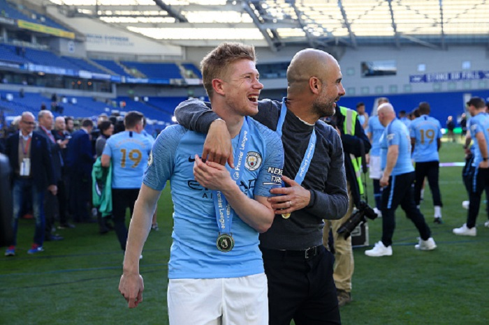 Pep Guardiola Manager of Manchester City celebrates with Kevin De Bruyne of Manchester City following the Premier League match between Brighton and Hove Albion and Manchester City at American Express Community Stadium on May 12, 2019 in Brighton, United Kingdom manchester city champions premier league