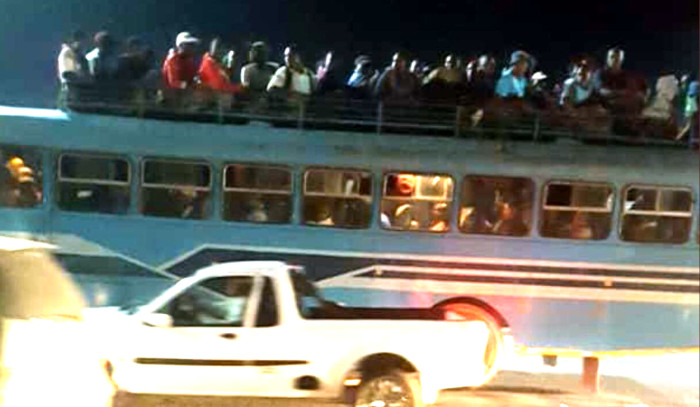 PICTURE: Zimbabweans Ride On Top Of Bus As Transport Situation Worsens