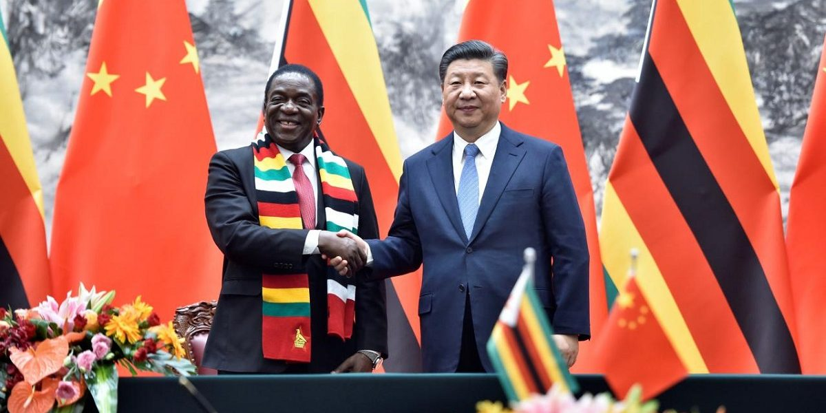 Chinese President Xi Jinping shakes hands with Zimbabwe President Emmerson Mnangagwa in China donation