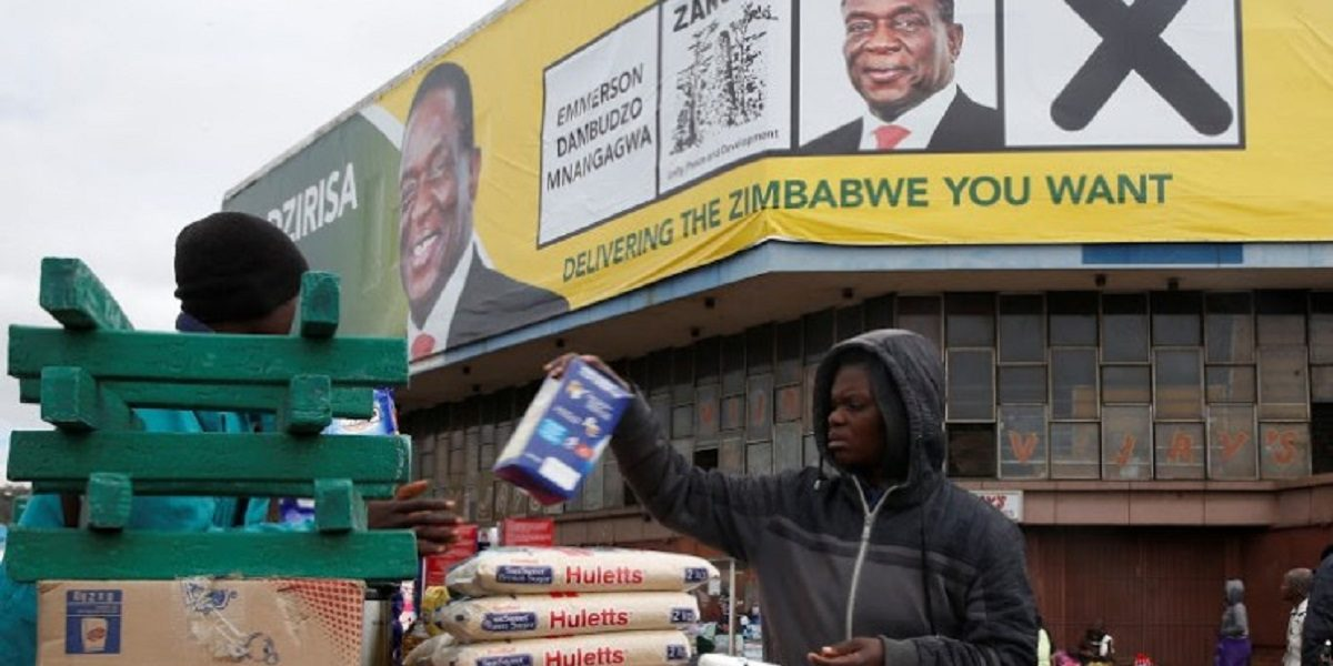 Man sells groceries behind Mnangagwa banner