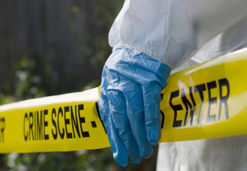 Forensic investigator working at a crime scene security guard murdered burnt Chiredzi