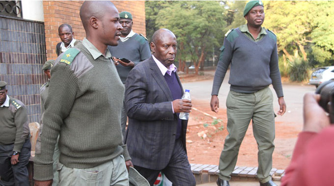 Former Energy and Power Development Minister Samuel Undenge being escorted into prison truck after being sentence to Four and half years in prison in Harare yesterday. Picture by Justin Mutenda released from jail