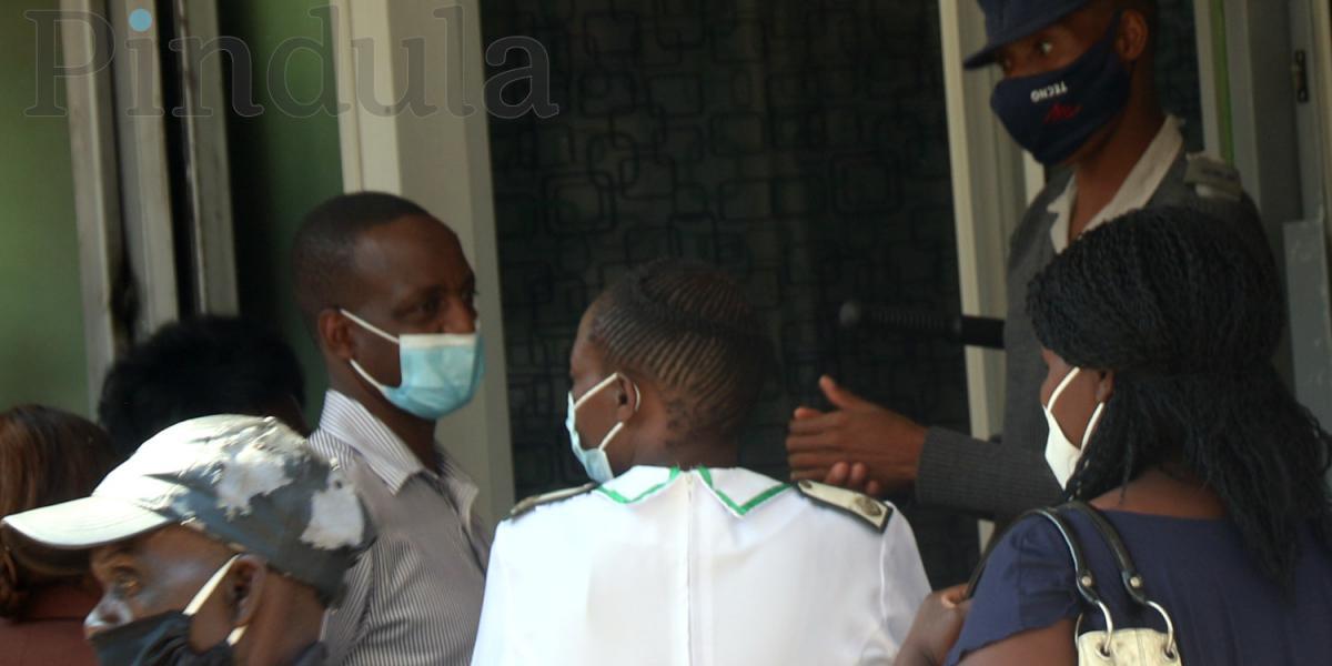 Zimbabwean nationals wearing masks