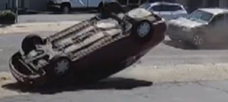 Car caught after stolen car overturned