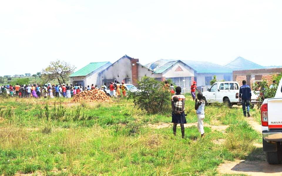 Suburban horror … Chivhu residents at scene of horrific crime