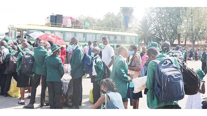 School children board buses to school