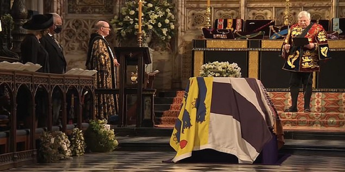 PRINCE PHILLIP's COFFIN LOWERED INTO VAULT