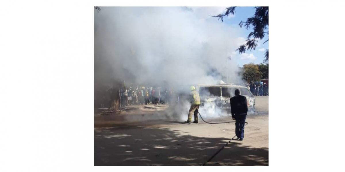 police tear gas kombis burnt to ashes