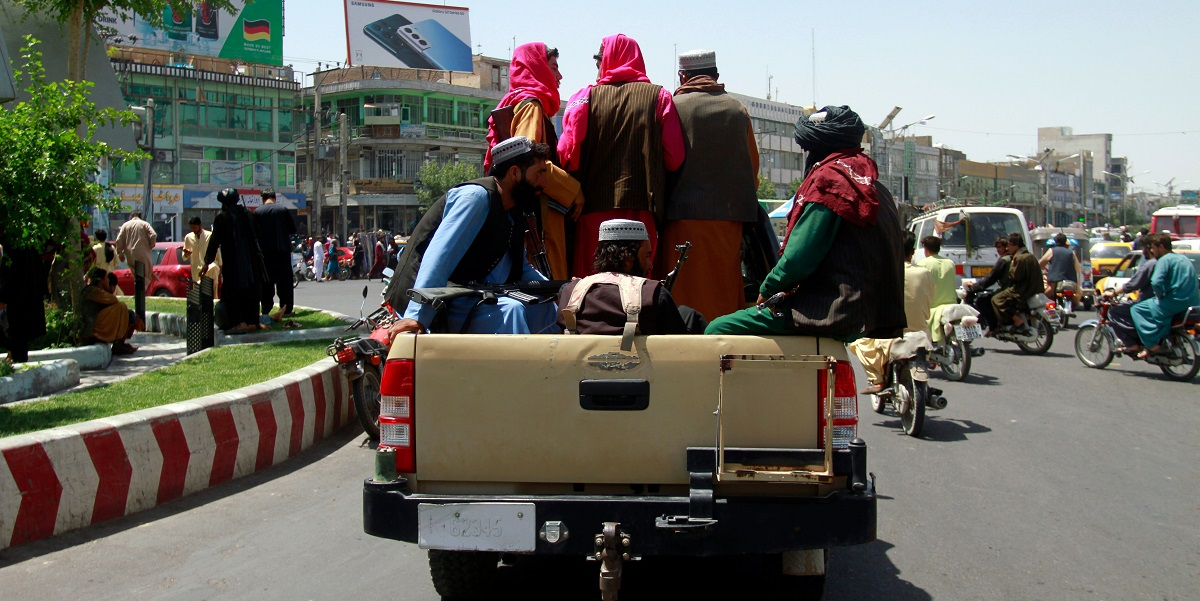 Afghanistan: Scores Queue For Passports, Visas, Money As Taliban Captures More Cities Taliban Promises Reforms Amid Fears Of Infringements Of Rights